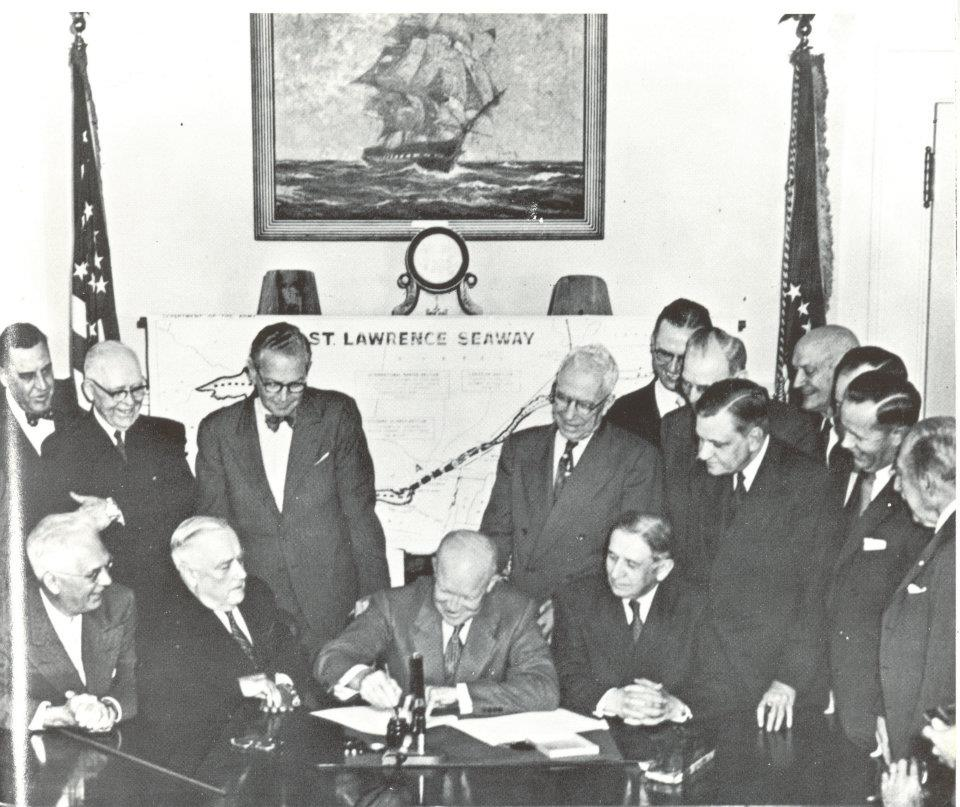 Dwight D. Eisenhower signing a document